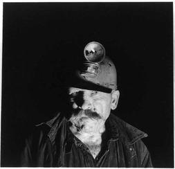 Photo: Andrew Scavnicky,1942,wearing carbide lantern on hard